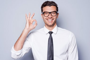 Man in shirt and tie gesturing OK sign