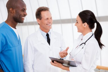 Confident doctors discussing something