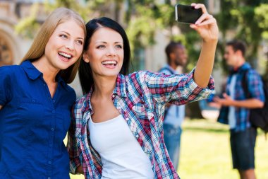 Beautiful young women making selfie
