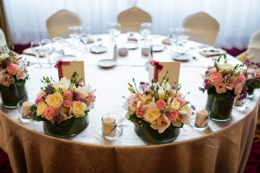 Wedding table with flowers arrangements