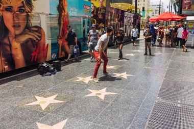 Tourists walking on the Hollywood Walk of Fame