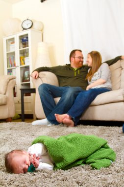 Newborn Baby Boy and Parents at Home