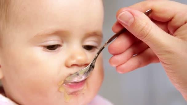 Feeding a small child, baby food,
