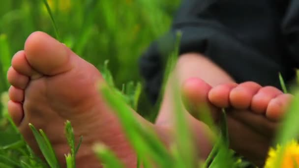 Feet and legs child, Babys feet in the grass