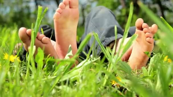 Feet and legs child, Baby's feet in the grass