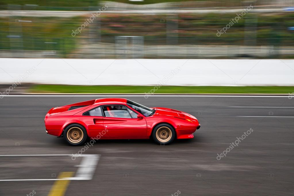 Old race car in action on track — Stock Photo © microlite #42403577