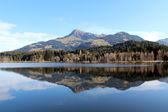 Fotografie Blick auf See und Berge am Schwarzsee Kitzbühel mit Alpenpanorama