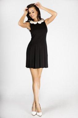Attractive brunette woman posing in studio.