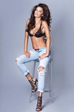 Sexy brunette woman posing