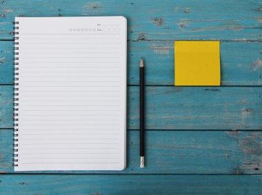 Notebook on desk stock vector