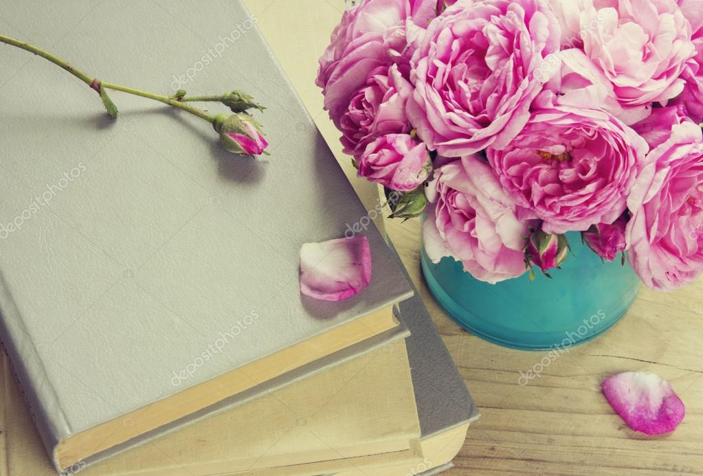 Pink roses in vase,books.Teachers day.Romantic literature.