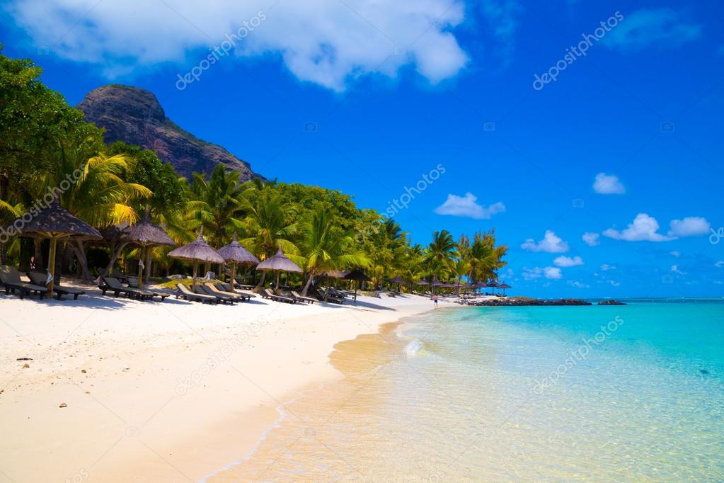 White sandy beach with umbrellas Mauritius