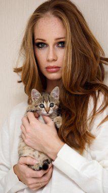 Beautiful girl with little kitty
