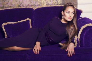 Beautiful glamour girl in purple dress