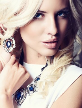 Portrait of beautiful sexy blond with jewellery