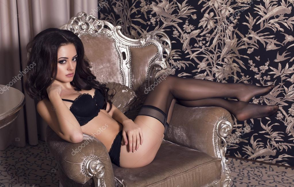 Sexy woman with black hair in lingerie
