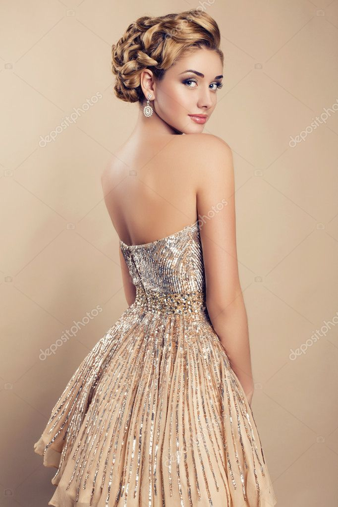Beautiful blond woman in elegant  dress