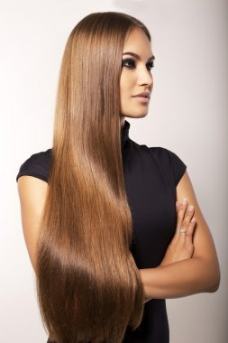 beautiful girl with luxurious long straight hair