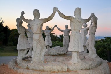 statues of people forming a team