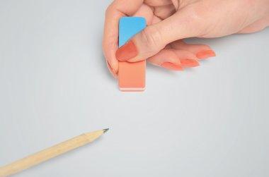 Woman hand erasing
