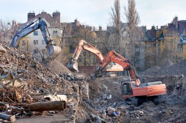 Demolition trucks in action. Demolition of an old block of flats.