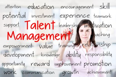 Business woman writing talent management concept. Office background.
