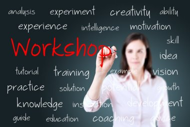 Young business woman writing workshop concept