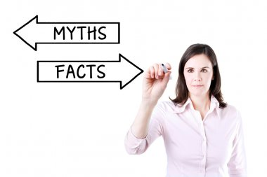 Businesswoman drawing a Myths or Facts concept on the virtual screen.