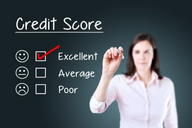 Hand putting check mark with red marker on excellent credit score evaluation form. Blue background.