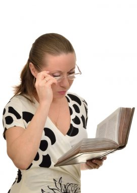 Woman reading a book attentively keen When