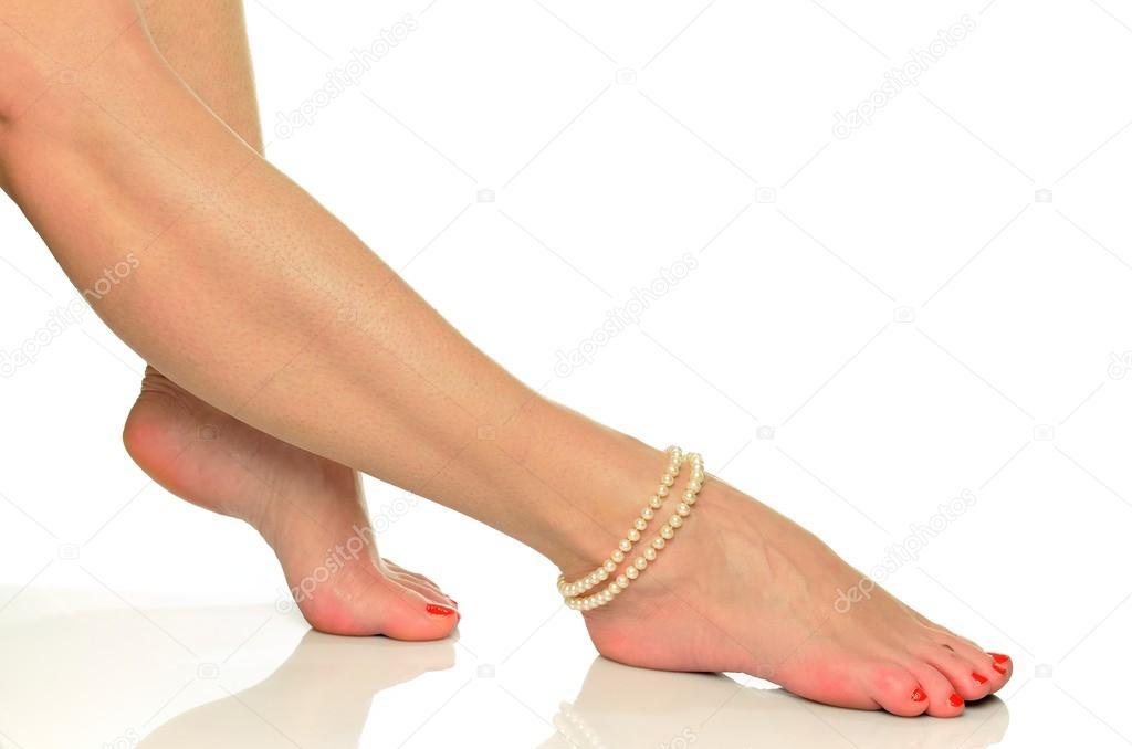 Female legs in pearl bracelet