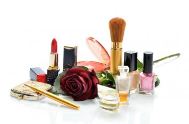 Items for decorative cosmetics makeup, jewelry, mirror and red flower