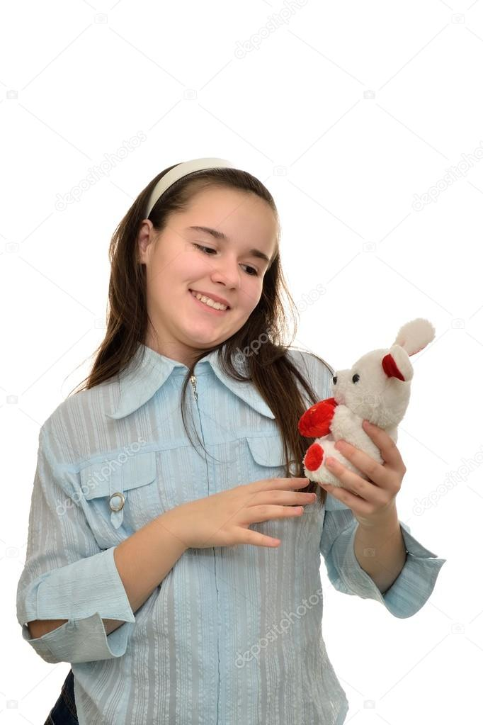 Teen Girl Holds Favorite Toy Hare Stock Photo