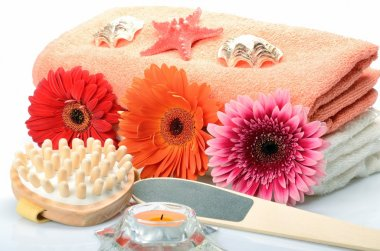 Towel and items for a pedicure and body treatments in the spa, sauna and bath still life