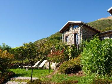 Pianello del Lario, Lake of Como, Italy: Panorama of the farm holidays Tre Terre stock vector