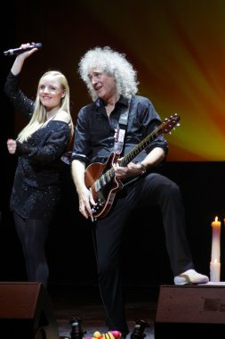 Brian May from Queen performs with Kerry Elils during