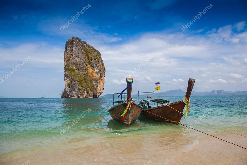 Tropical beach, traditional long tail boats