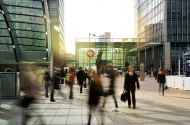 LONDON, UK - MARCH 10, 2014: Canary Wharf business aria with more than 100.000 working places. Tube entrance and early morning commuters
