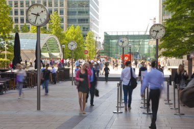LONDON, UK - JULY 03, 2014: People blur. Office people moving fast to get to work at early morning in Canary Wharf aria
