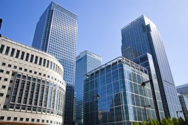 LONDON, CANARY WHARF UK - JULY 13, 2014: - Modern glass architecture of Canary Wharf business aria, headquarters for banks, insurance, media and other world known companies.