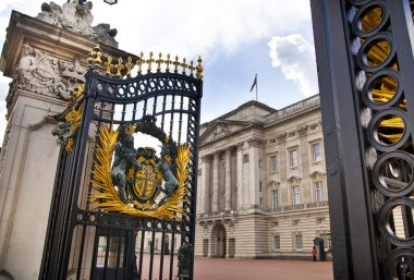 LONDON, UK - MAY 14, 2014: Buckingham Palace the official residence of Queen Elizabeth II and one of the major tourist destinations U.K. Entrance and main gate with lanterns