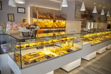 MADRID, SPAIN - MAY 28, 2014: Local coffee shop and variety of baked products