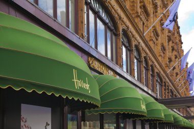 LONDON, UK - JUNE 3, 2014: Harrods department store, shopping and restaurants tourists point. Harrods was opened at 1849 and now it is one of the most famous luxury store in London.