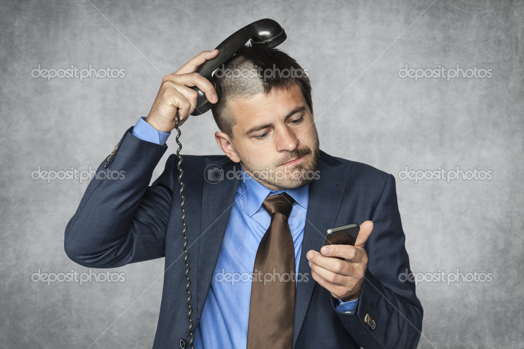 Businessman With A Funny Haircut Can Not Handle Phone Stock - Businessman haircut
