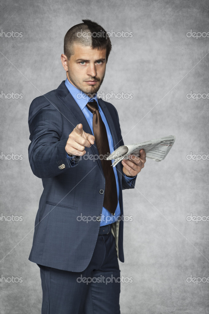 Businessman With A Funny Haircut Pointing To You Stock Photo - Businessman haircut