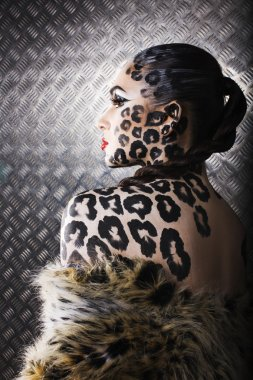 portrait of beautiful young european model in cat make-up and bodyart