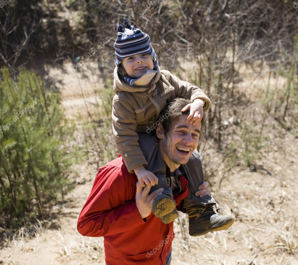 Happy father with son in forest playing