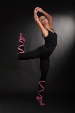 flexible girl on a black background