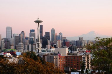 Beautiful city of Seattle glowing at dusk with Mount Rainier