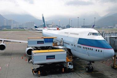 Flight loading cargo and food at Hongkong airport terminal stock vector